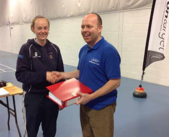 Our ClubMark Renewal Folder is handed over to Arran Coggan.