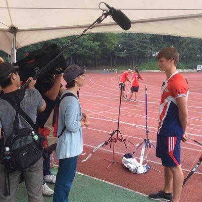 Tom getting some earlier media practice in Korea.