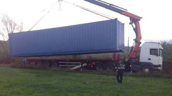 Container about to be lifted into its temporary position.