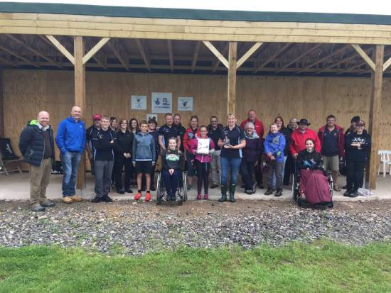 Members receiving the Ontarget 'Club of the Year' Award infront of our new Covered Shooting area, on a not so great wet June evening.