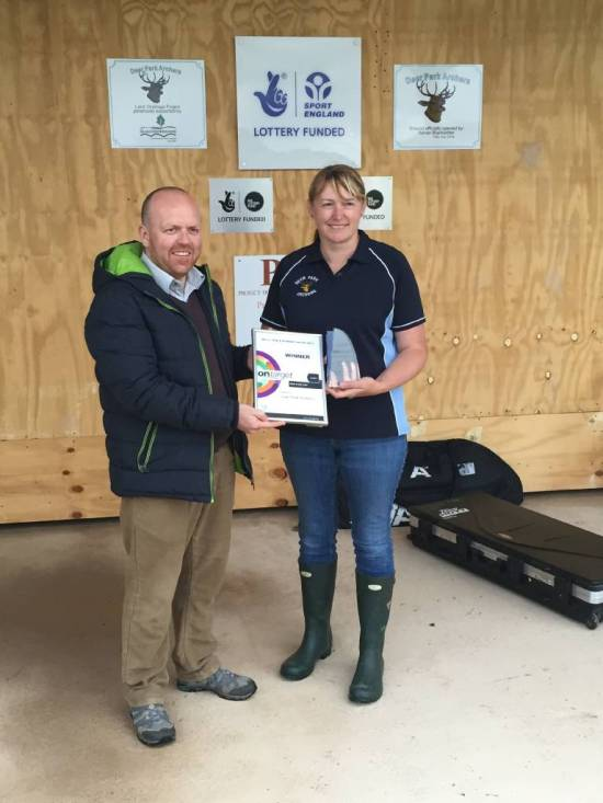 Christine Anderton receiving the Ontarget 'Club of the Year' Award from Arran Coggan.