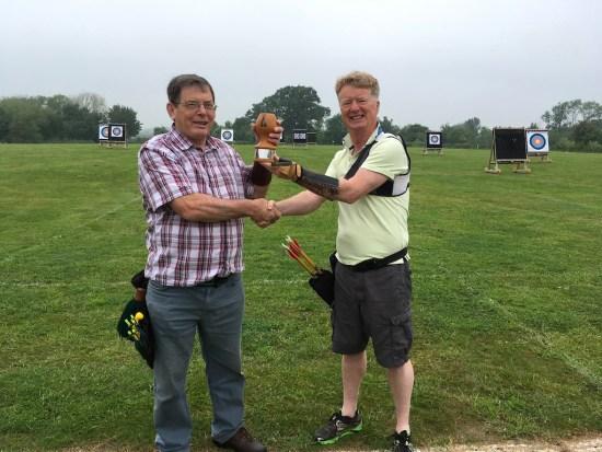 John receiving the Award from David Ponton.