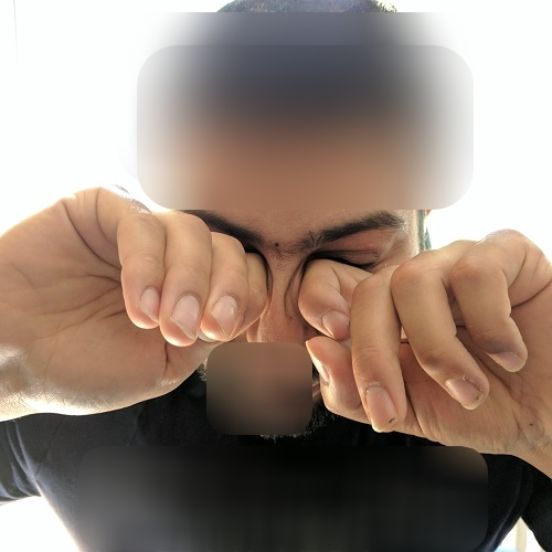 eye rubbing with the knuckes