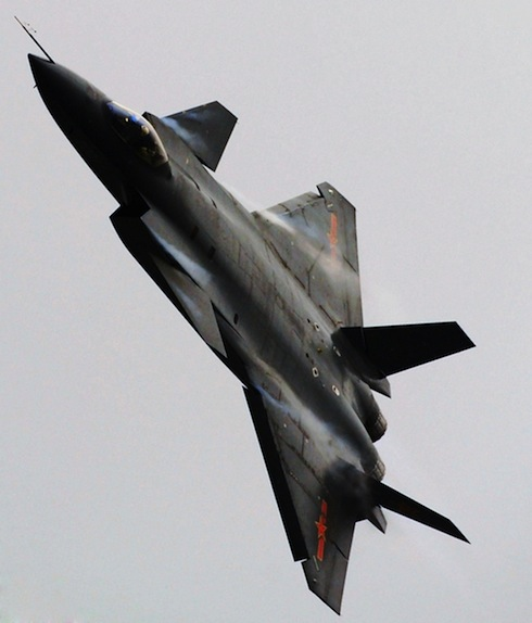 Chengdu J-20 fifth generation fighter from China banks into a high angle turn.