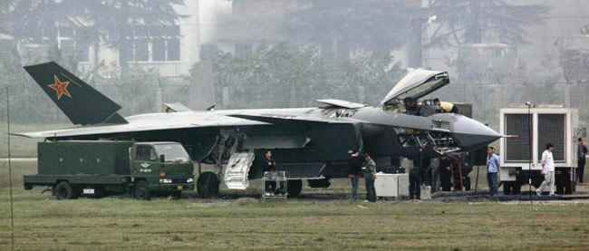 The latest J-20 prototype now depicts dorsal and forward fuselage access to avionics bays; the pitot tube was repositioned at the tip of the nose cone, opening the nose cone space for AESA radar and Electro-Optical Infra-Red Search / Track (IRST) sensors.