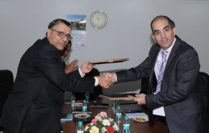 Mr H N Ramakrishna, Director (Marketing), BEL, and Mr Adi Dar, Executive VP, Managing Director of Elbit Systems Electro-optics-Elop Ltd., Israel, exchange documents after the signing of the MoU at Aero India 2013 in Bengaluru.