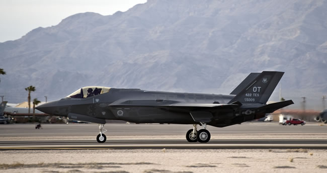 One of two Lockheed Martin F-35 Lighting IIs lands at Nellis Air Force Base, Nev., March 6, 2013. Photo: Airman 1st Class Christopher Tam, US Air Force