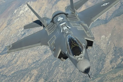 F-35A test aircraft AF-4, captured during refueling from the U.S. Air Force tanker.