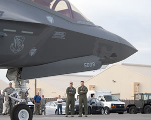 Maj. Gen. Jeff Lofgren (left), U.S. Air Force Warfare Center commander, and Brig. Gen. Charles Moore (right), 57th Wing commander, wait to greet the pilots of the two F-35 Lighting IIs that arrived at Nellis Air Force Base, Nev., March 6, 2013