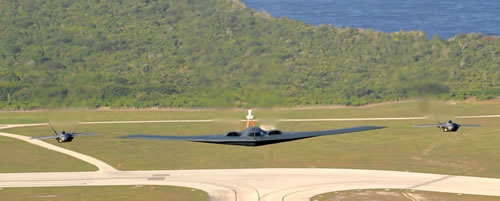 B2 Spirit escorted by two F-22A Raptors flying over Anderson AFB, Guam. US Air Force photo