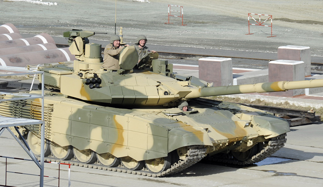 Deputy P.M. in charge of defense industry Dimitry Rogozin takes a ride on the T-90M at the demonstration and testing track at Niznhy Tagil.