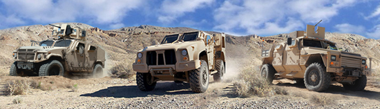 Three prototypes for the Joint Light Tactical Vehicle are undergoing testing. The AM General Prototype is on the left, Oshkosh JLTV in the center, and the Lockheed Martin prototype is on the right.