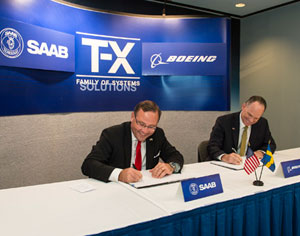 Boeing [NYSE: BA] and Saab AB [Stockholm: SAABB] have signed a Joint Development Agreement (JDA) to jointly develop and build a new advanced, cost-efficient T-X Family of Systems training solution for the upcoming competition to replace the U.S. Air Force's aging T-38 aircrew training system. Saab President and CEO Håkan Buskhe, left, and Boeing Military Aircraft President Chris Chadwick sign the Joint Development Agreement document. Photo: Boeing