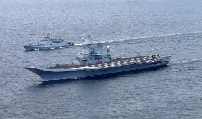 Another view of INS Vikramaditya escorted by INS Talwar.