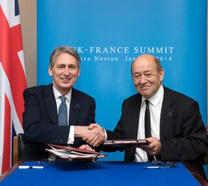 Defence Secretary Philip Hammond shakes hands with the French Defence Minister Jean-Yves Le Drian at today's Anglo French Summit at RAF Brize Norton, January 31, 2014. Photo: UK MOD Croen Copyright