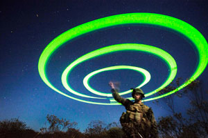 A student from the Infantry Officer Course (IOC) at Marine Corps Base Quantico, Va. marks the rendezvous point for the raiding force upon arrival at the target. USMC photo by Sgt. Tyler Main