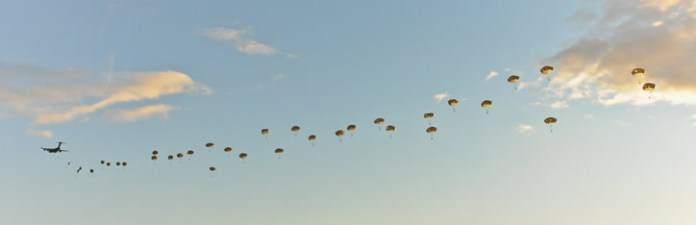 Paratroopers of the U.S. Army's 4th Brigade Combat Team (Airborne) 25th Infantry Division parachute over the Malemute Drop Zone at Joint Base Elmendorf-Richardson, in Alaska, April 2013. Photo: US Army