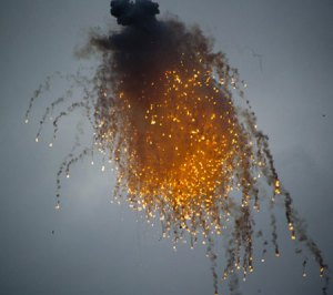 Smoke screening is part of a multi-layered defense of surface vessels, which also includes active defense (air defense missiles), active decoys (jammers and RF decoys) chaff. The flares (seen in this photo) may be used for a last ditch defense, luring thermal seekers off target.