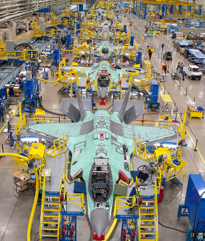 The JSF F-35 assembly line at Fort Worth, Texas. Lockheed Martin, the prime contractor, Northrop Grumman and BAE Systems, as the leading partners in the program are expected to invest $170 million improving production efficiency, toward bringing the production cost down to the level of current (fourth generation) fighter jets by 2019-2020.