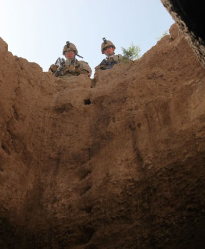 US soldiers inspect a water well, connected to an underground tunnel system, used to store rainwater in the afghan winter. In the dry season, these systems are often used to store  caches of weapons and improvised explosive device. Photo: US Marine Corps, by Sgt. James Mercure.