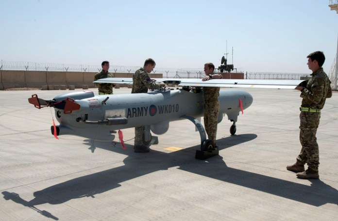 Assembling a Watchkeeper Unmanned Aerial Vehicle (UAV) in Camp Bastion, Afghanistan, 23rd September 2014. Photo: MOD, Crown Copyright
