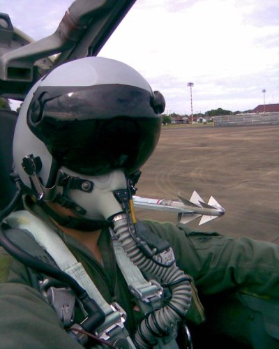 A pilot of the Royal Thai Air Force preparing for a mission in an upgraded F-5T, wearing a DASH helmet. Note the Python IV missile on the wingtip.