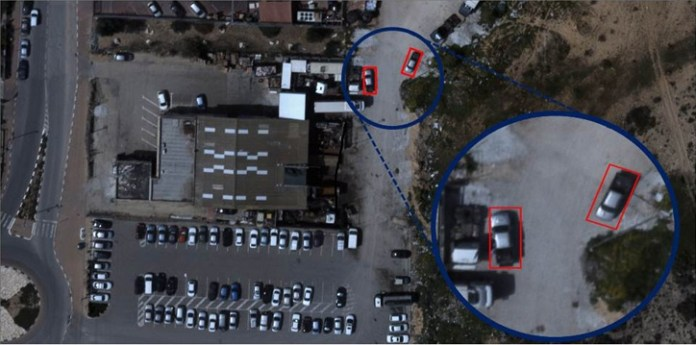 Visual Profiler, developed by Video Inform and operationally deployed for automatic analysis of aerialimages can scan large image databases, real-time or historic, to detect targets of interest. This example shows the systems spotting pick up truck shapes vehicles using automatic detection. The system can further recognize even finer details, such as specific distinguishable details such as color, make, and unique, distinctive characteristics through automtaic-processing
