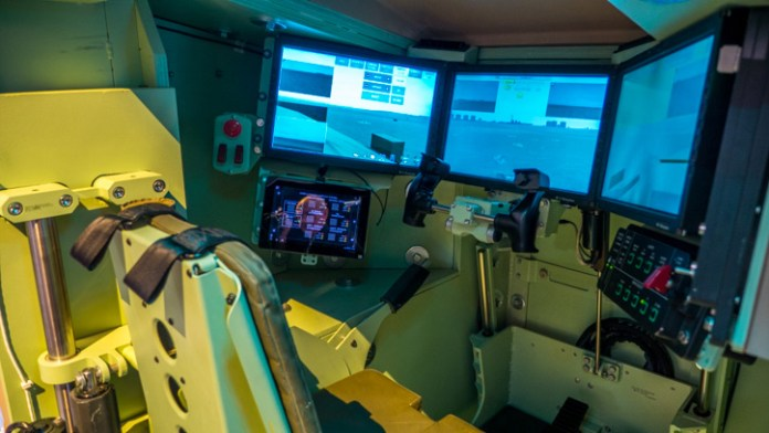 This driver's position displayed at BAE Future Technology Demonstrator for the Army Force 2025 Vision at AUSA 2014 shows the drivers' display consoles, proving 120 degrees coverage, in addition, live images from side and rear cameras provide 360 vision to the driver and commander. direct vision blocks augment this indirect view with periscope vision. Five blocks are positioned just below the raised hatch line, providing 180 degrees coverage.