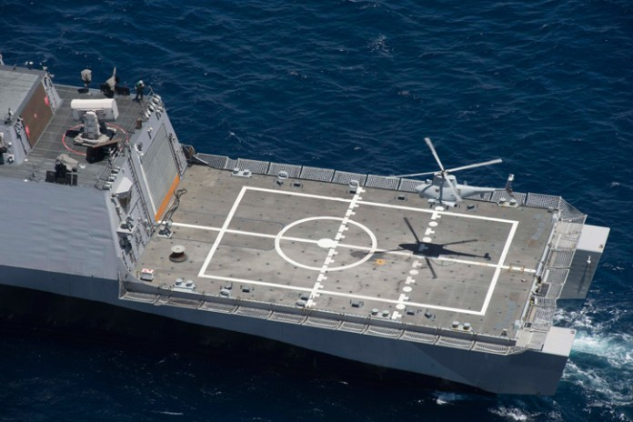 An MQ-8B Fire Scout unmanned helicopter assigned to Helicopter Maritime Strike Squadron (HSM) 35 prepares to land on the aft deck of the Littoral Combat Ship USS Freedom (LCS 1) on May 12, 2014, during a visit, board, search and seizure (VBSS) training off the coast of Southern California. The training marked the first time the littoral combat ship, an MQ-8B and an SH-60R Sea Hawk helicopter conducted integrated VBSS training. Photo: US Navy