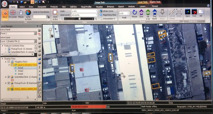 Multiple vehicles of a specific type detected by the system in a parking lot. Video Inform photo, from display