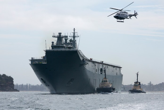 Landing Helicopter Dock NUSHIP Canberra, entered Sydney Harbour for the first time during the contractor sea trials and testing program. Photo: RAN by Steven Thomson