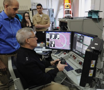 Rear Adm. Matthew Klunder, chief of naval research, tracks targets during a tour of Naval Directed Energy Center and the Office of Naval Research's (ONR) Laser Weapons System (LaWS) program at Dahlgren in March 2014. (U.S. Navy photo by John F. Williams)