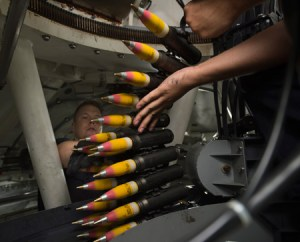 Gunners load high-explosive incendiary tracer rounds into the ammunition feeder-can of a 30mm weapons system aboard the littoral combat ship USS Fort Worth (LCS 3). Photo: U.S. Navy, by Antonio Turretto
