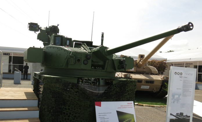 The T40 turret Nexter is developing for the ERBC integrates the CTA 40 mm cannon, MMP missiles (carried in armoured containers on the turret sides) and remotely operated 7.62mm machine gun on the top. The turret also mounts multiple optronic systems supporting the different weapons. The T40 was shown by Nexter for the first time during Eurosatory 2014. Photo: Tamir Eshel, Defense-Update