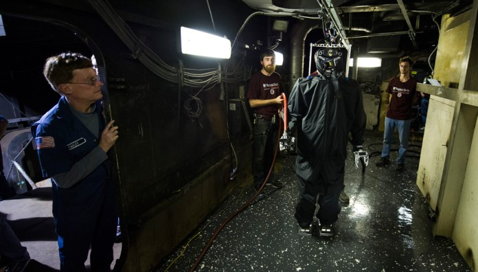 """""""We set out to build and demonstrate a humanoid capable of mobility aboard a ship, manipulating doors and fire hoses, and equipped with sensors to see and navigate through smoke,"""" said Dr. Thomas McKenna, ONR program manager for human-robot interaction and cognitive neuroscience. """"The long-term goal is to keep Sailors from the danger of direct exposure to fire."""" Photo: US Navy"""