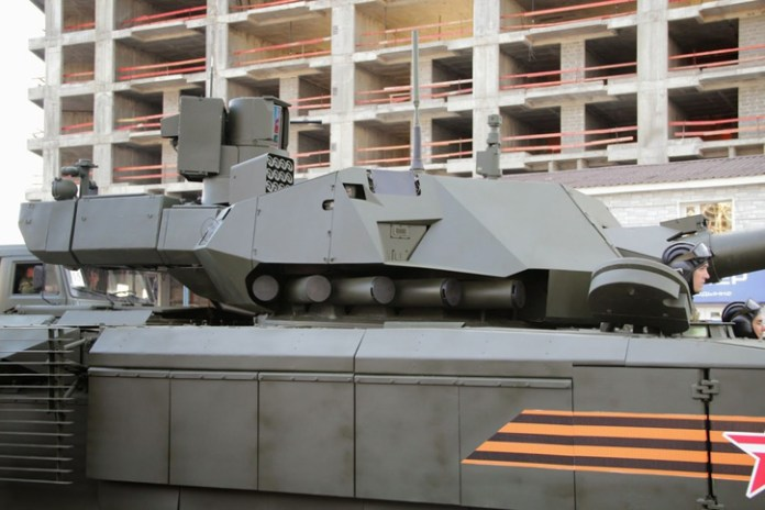 The T-14 tank mounts two active protection assemblies on both sides of the turret. Covered by passive armor for ballistic protection, these modules integrate the Afghanit sensor (trapezoidal unit), five hard-kill launch tubes mounted at the turret's base, two peripheral cameras and flat (possibly covered) sensor, likely  radar coupled with the soft-kill system. Some sources indicate these sensors are derived from AESA radar technology developed and implemented on the Sukhoi T-50 stealth fighter jet. The rotatable soft-kill launcher containing 12 cartridges can be seen above, mounted on a rotating pedestal.