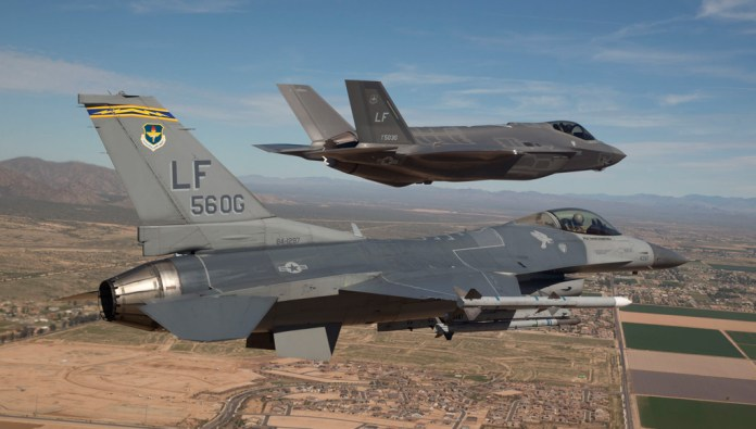 4GEN welcomes 5 GEN: The first F-35 arrives at Luke Air Force Base, Ariz., escorted by an F-16. (Photo: USAF by Jim Hazeltine)