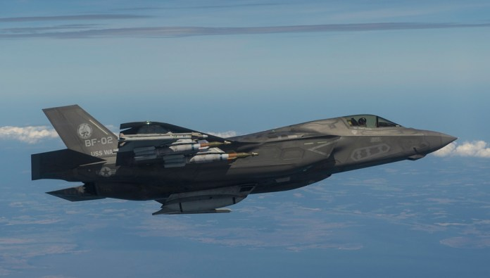 And F-35B during asymmetrical stores testing over the Eastern Shore of Maryland on May 26, 2015. Photo:
