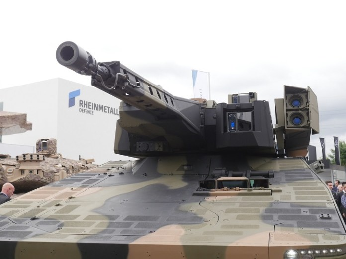 The Lance is a manned turret mounting Rheinmetal's 35mm cannon, a machine gun with three replaceable barrels and a launcher pod carrying two Spike LR missiles. Photo: Noam Eshel, Defense-Update