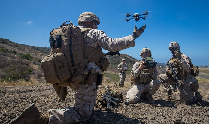 U.S. Marine Lance Cpl. Benjamin Cartwright, an infantry Marine with Kilo Company, 3rd Battalion 5th Marine Regiment, launches the Instant Eye MK-2 Gen 3 unmanned aerial system during an exercise for Marine Corps Warfighting Laboratory's Marine Air-Ground Task Force Integrated Experiment at Camp Pendleton, CA. (U.S. Marine Corps photo by Pfc. Rhita Daniel)