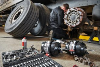 road safety lorry tyres being repaired in a workshop