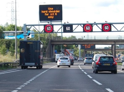 managed motorway signs set at 60 mph on a busy motoriway