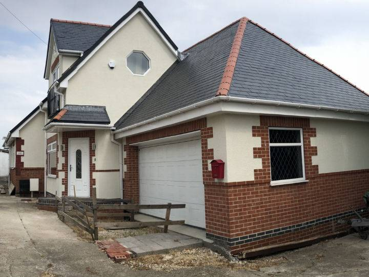 rendered and brick house and garage