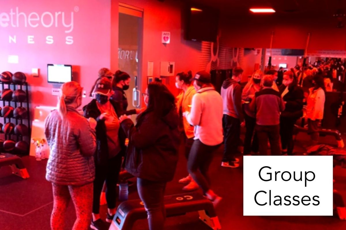 photo of Orange Theory Fitness studio with words group classes