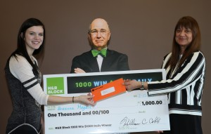 """Breanna Hogan receives her """"1,000 Win $1,000"""" Daily Sweepstakes check from H&R Block Forsyth Office Manage Leslie Killingsworth on Wednesday, Feb. 17, 2016. (submitted photo)"""