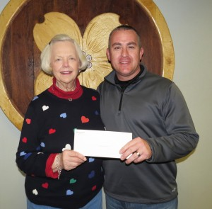 Central Bank of Branson Senior Vice President Karen K. Hall presents a check to Dr. Todd Wright, Executive Director of Christian Action Ministries.