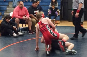 With first-year head coach Greg Domestico looking on, the Greenwich High School wrestling team took to the mat at the Danbury Holiday Tournament. (Evan Triantafilidis photo)