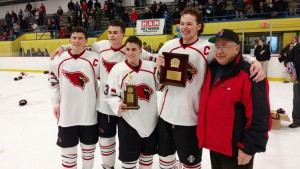 The Greenwich High School ice hockey captains pose for a photo with the FCIAC championship trophy after Big Red's 5-0 victory over St. Joseph. (Paul Silverfarb photo)