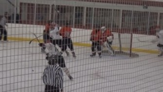 Colin Kelly slaps this shot past Ridgefield's goalie to put Greenwich up 3-2.