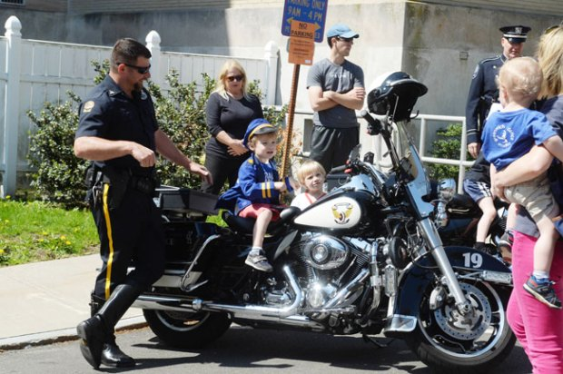 Kids hang out on officer's motorcycle